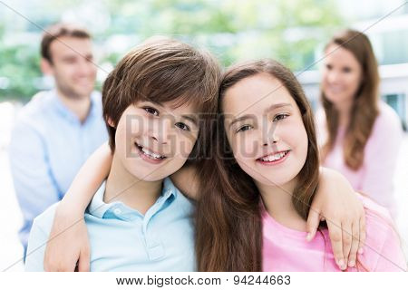 Children smiling with parents in background