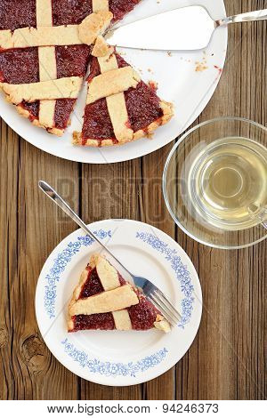 Lattice Cake With Strawberry Jam Cut With Metal Spatula, Piece Of Cake And Green Tea