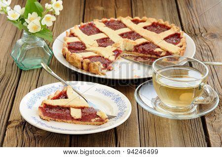 Lattice Cake With Strawberry Jam Cut, Piece Of Cake, Jasmine Flowers And Glass Tea Cups