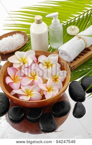 set of zen stones and Frangipani in bowl and palm leaf