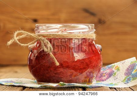 Homemade Strawberry Jam In Glass Jar With Hempstring On Paper Napkin