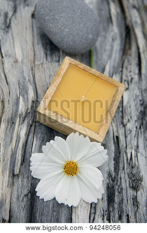 driftwood texture and white flower ,candle ,stones