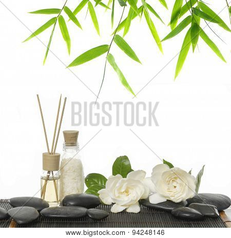 Set of massage oil , stones, , gardenia on bamboo mat