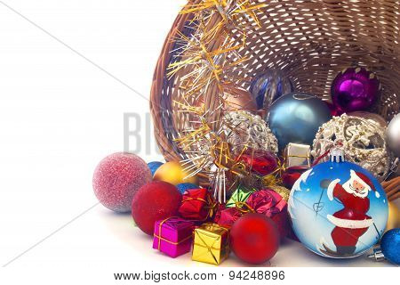 Inverted Basket With Christmas Toys On A White Background Closeup