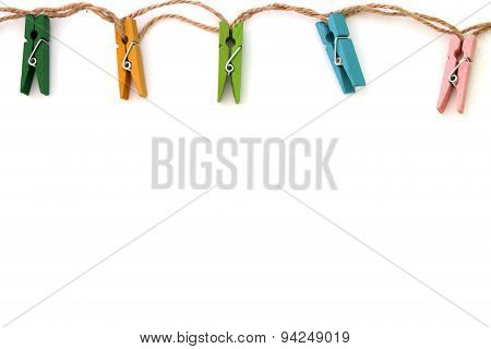Background Of Colored Linen Clothespins Isolated On White Close-up