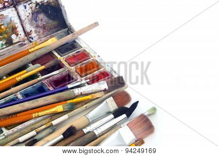 Brushes And Paint On A White Background