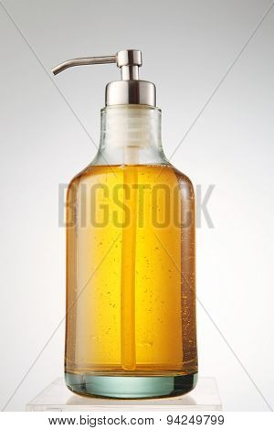 yellow color soap in the dispenser