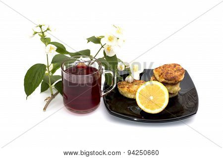 Tea, Lemon And Cheesecakes On A Plate The Drinks Decorated With A Flower Branch