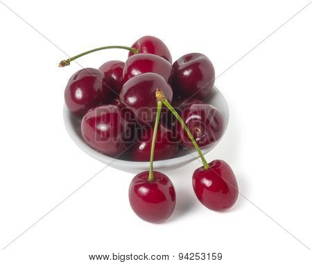 Ripe Cherry On A Saucer. Isolated On White Background