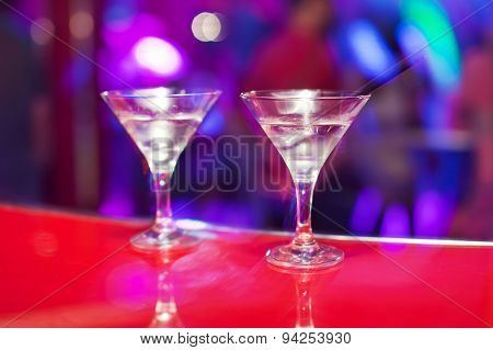 Two glasses with martini on the bar counter