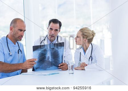 Team of doctor looking at Xray in medical office