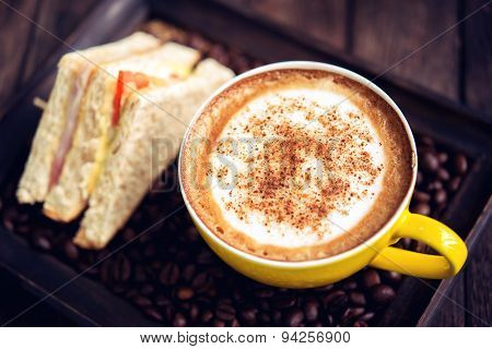 Coffee Mocha Hot And Sandwiches On Wooden Table