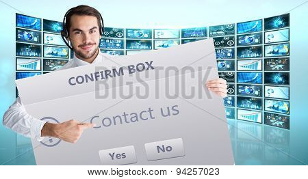 Businessman with headphone showing sign to camera against confirm box