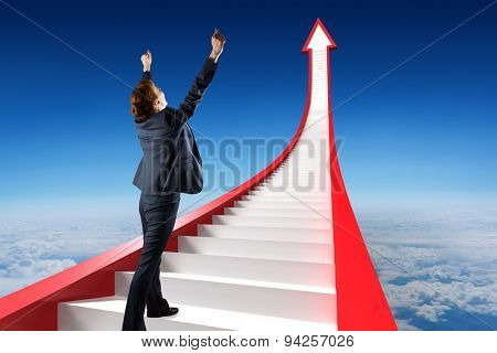 Businesswoman cheering against blue sky over clouds at high altitude