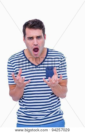 Angry hipster with mouth open on white background