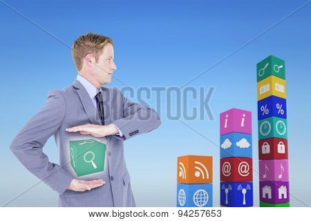 Handsome businessman gesturing with hands against bright blue sky