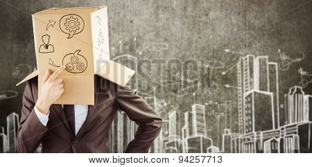 Anonymous businessman touching his chin against hand drawn city plan