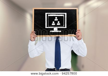 Businessman showing board against college hallway