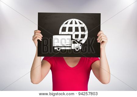 Casual woman showing board against grey background