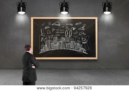 Thinking businessman against blackboard with copy space