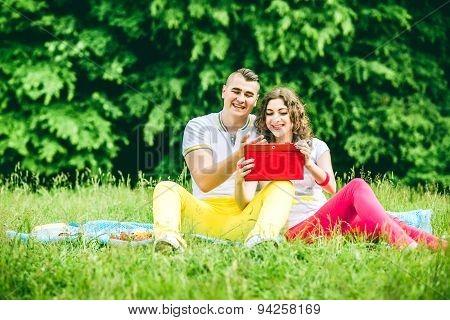 Happy Couple Relaxing Outdoor In The Green Park