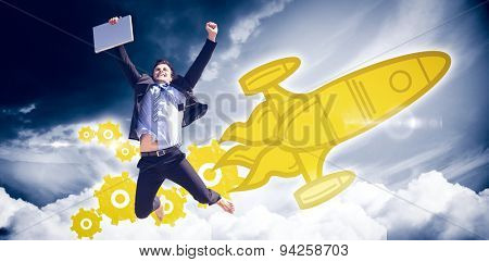 Cheering businessman against blue sky