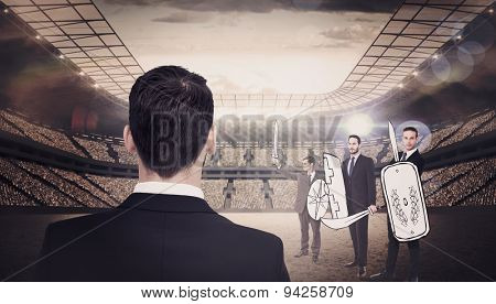 Rear view of businessman in suit standing against stadium