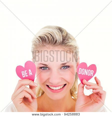 Attractive young blonde holding little hearts against be a donor