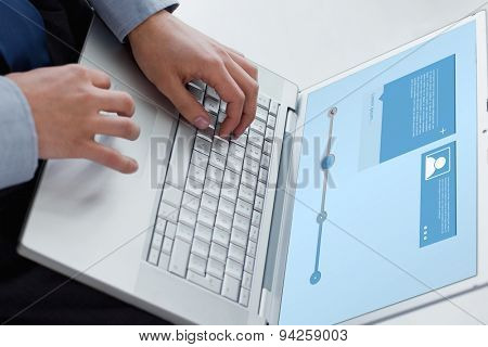 Website interface against angle view of hands typing