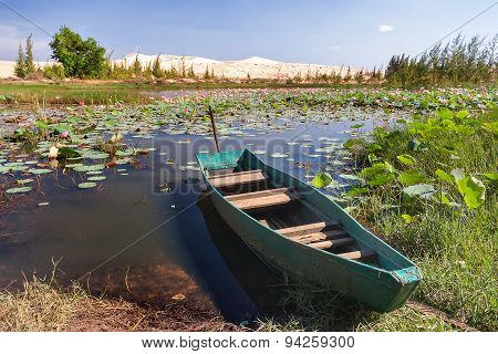 The Boat Lies On The Bank Of The Lake Of Lotuses At White Sand Dunes - Bau Sen, Bau Trang.