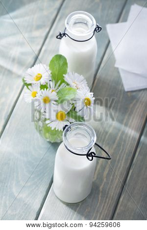 Milk with summer flowers