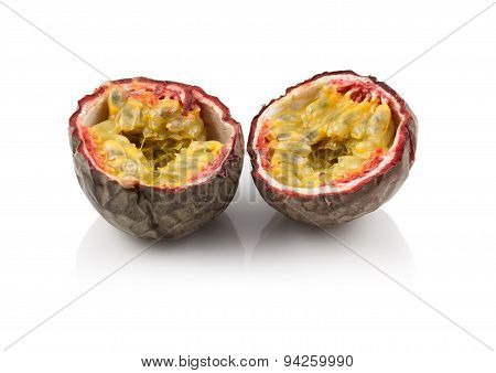 One passion fruit split in half isolated on white