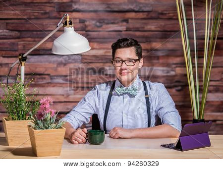 Lesbian In Stylish Office At Wood Desk