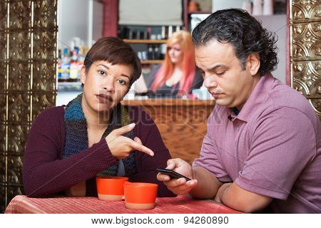 Woman Pointing At Cell Phone