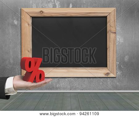 Man Hand Holding Red Percentage Sign With Blank Blackboard