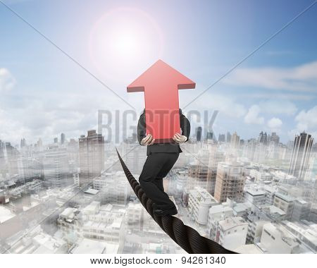 Businessman Carrying 3D Red Arrow Sign Balancing On Wire