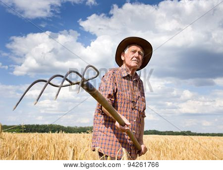 Farmer With Hayfork