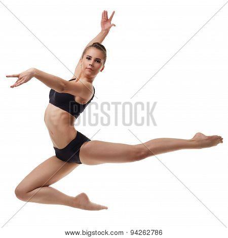 Beautiful female dancer posing in graceful jump