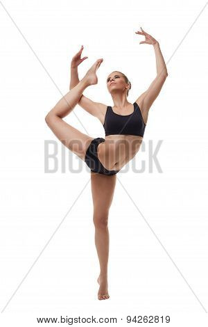 Attractive young dancer posing in graceful pose