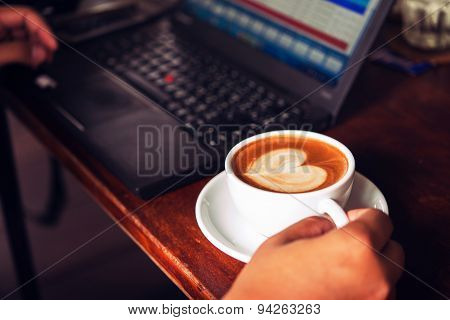 Businessman Is Working With Laptop, Holding A Mobile Phone