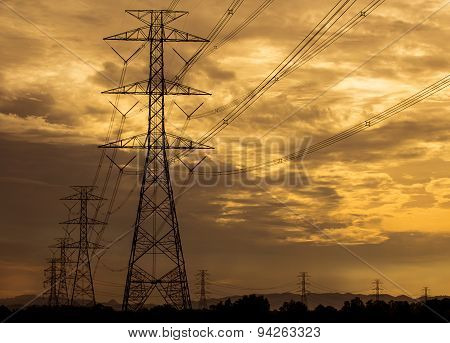 High Voltage Tower With Sunset Background