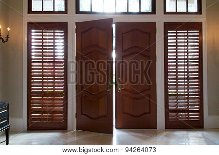 Door Ajar With Light Shining In
