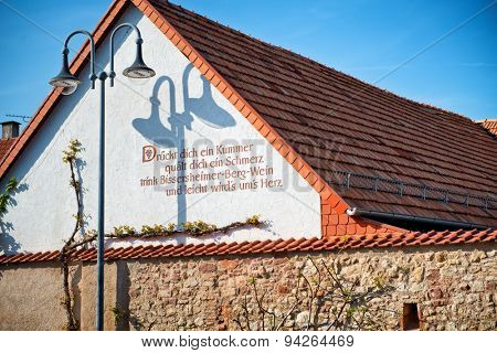 Architectural Detail of Slogan Painted on Exterior of Building Wall in Wine Region of Bissersheim, Rhineland-Palatinate, Germany