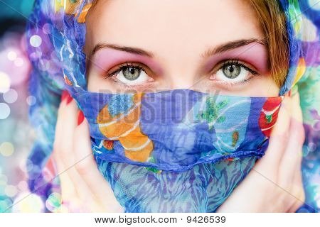 Woman With Beautiful Eyes And Colorful Scarf
