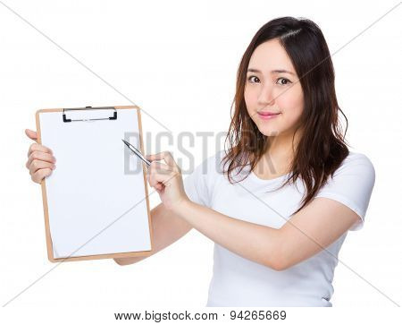 Young girl pen point to blank paper of clipboard