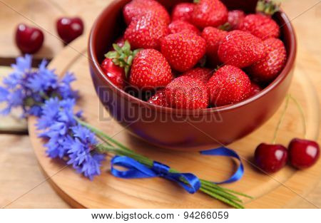 sweet berries on wooden table