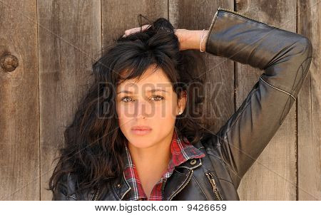 Beautiful woman in front of a fence.