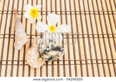 Tropical Plumeria And Stone Therapy On Bamboo Mat