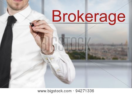Businessman Writing Brokerage In The Air