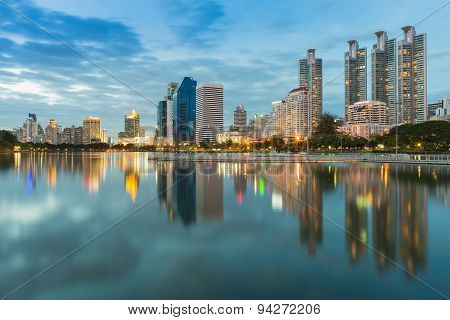 Bangkoks business district during sunset with water reflection Thailand